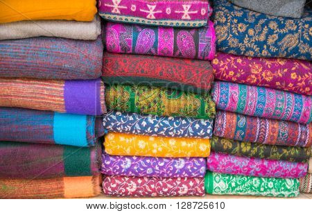 Bright oriental coloured cloth fabric background from Nepal and India