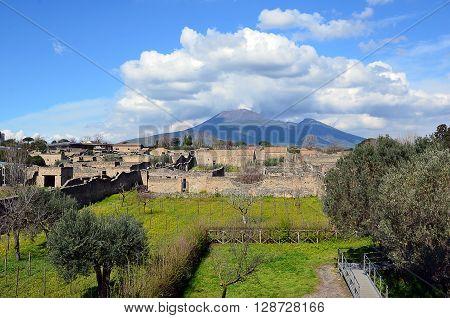 Vesuvius volcano cloudy sky view from pompei city excavation