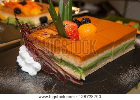 Close up shot of thai tea cake on stand