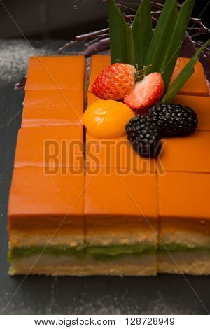 Close up shot of thai tea cake on stand ** Note: Shallow depth of field