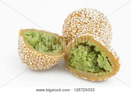 Traditional asian dessert, two sesame balls on the white background