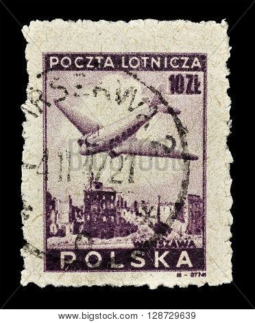 POLAND - CIRCA 1946 : Cancelled postage stamp printed by Poland, that shows plane over Warsaw.