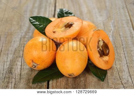 Japanese loquat on a wooden background close up