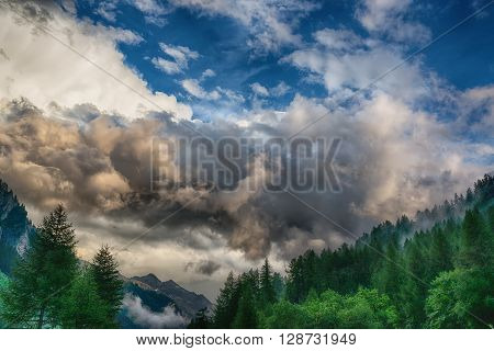 Thunderstorm formation over the mountains dramatic sky of summer season