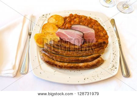 Traditional Croatian cuisine, homemade sausage from the tavern with beans and potatoes