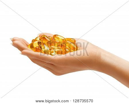 Hand is giving Omega 3 capsules isolated on white background. Palm up close up. High resolution product.