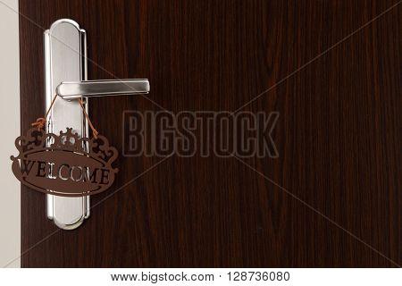 welcome door sign on the door handle