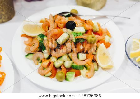 tasty salad. Vegetable salad with shrimp and mussels
