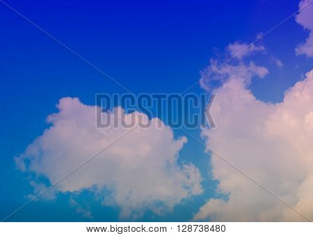 blue sky background with tiny clouds;clouds in the blue sky