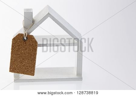 model house with a price tag