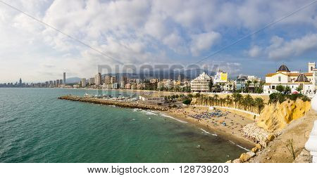 BENIDORM SPAIN - OCTOBER 06 2014: People relaxing on the beach of Mediterranean resort Benidorm province of Alicante Spain