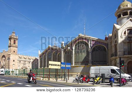 VALENCIA SPAIN - OCTOBER 07 2014: Santos Juanes church and Mercado Central in Valencia Spain. Historic Mercado Central is one of the oldest markets in Europe