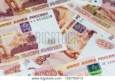 Scattered ruble diffrent banknotes close up view