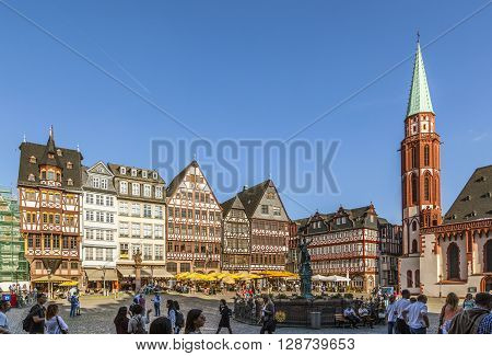 People At Roemerberg, A Row Of Half-timbered Houses At The East Side Square Known As The Ostzeil