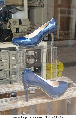 LEIPZIG GERMANY - CIRCA MARCH 2016: glossy blue high heel shoes on display in a window shop