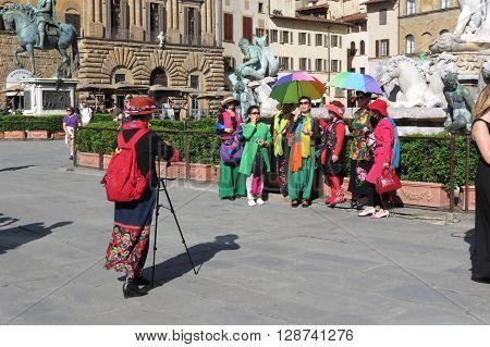 FLORENCE ITALY - CIRCA JUNE 2016 - Asian tourists taking pictures on Piazza della Signoria