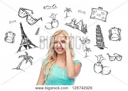 people, tourism, vacation and summer holidays concept - smiling young woman or teenage girl making ok hand gesture over touristic doodles