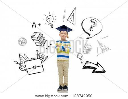 childhood, school, education, learning and people concept - happy boy in bachelor hat or mortarboard with doodles