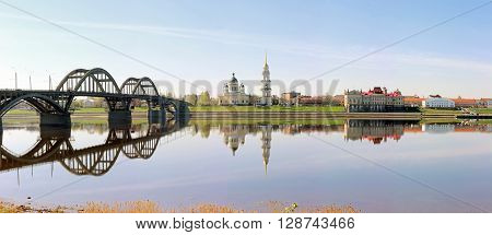 Panorama of the Volga river in Rybinsk overlooking the Cathedral the bridge and the Museum on a clear spring day.