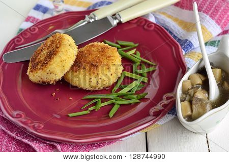 Fried potato cutlets /patties/ with mushroom sauce