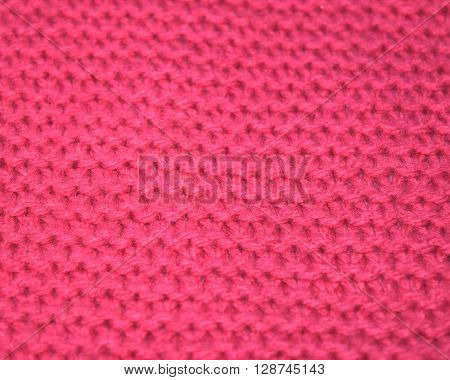 close up knitted texture fabric background in pink wool