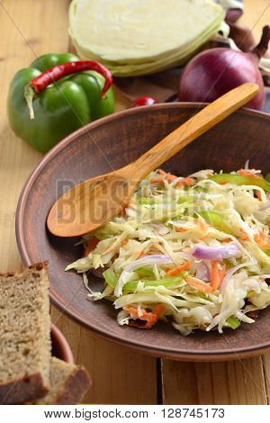 Sauerkraut with onions carrots and peppers, vertical