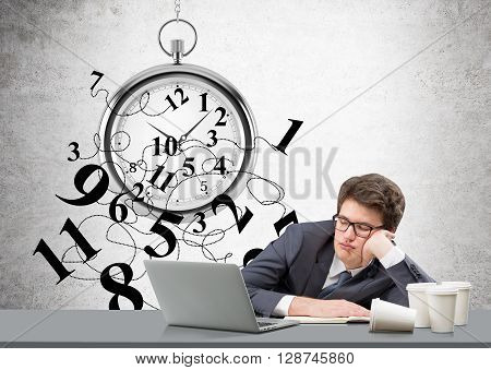 Time management concept with broken clock and sleepy businessman at desk with laptop and various coffee cups