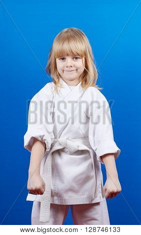 A girl stands in rack of karate