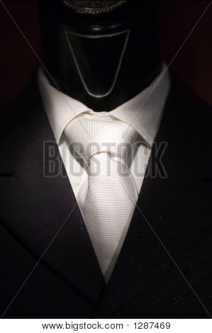 White Tie And Black Suit On Shop Mannequins