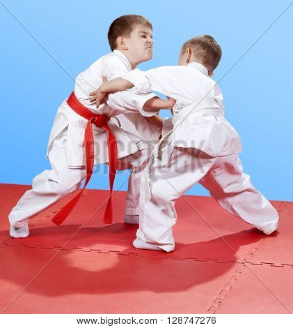 Two little boys are training judo sparring