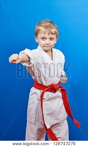 With a red belt boy beats punch arm