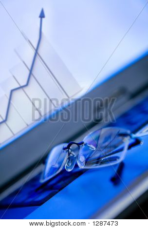 Glasses On Laptop Showing A Growth Financial Graph