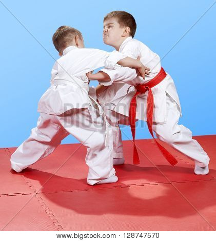 Young athletes learn the techniques of Judo