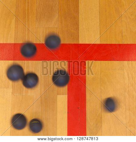 black squash balls on the sqash court