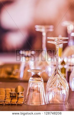 glasses and cutlery in a restaurant table setting