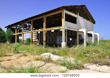 Ruined ramshackle building in abandoned industrial  zone.