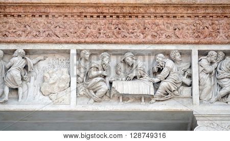 BOLOGNA, ITALY - JUNE 04: Supper at Emmaus by Zaccaria da Volterra, door of San Petronio Basilica in Bologna, Italy, on June 04, 2015