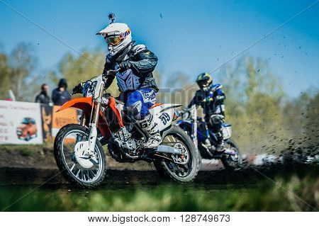 Miasskoe Russia - May 02 2016: athlete on bike from under wheels of earth and dirt during Cup of Urals motocross