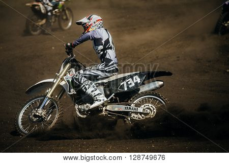 Miasskoe Russia - May 02 2016: athlete motorcyclist riding on track under wheels of dirt during Cup of Urals motocross