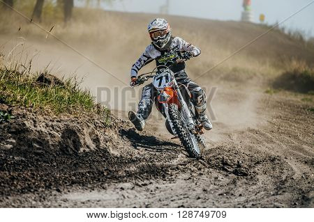 Miasskoe Russia - May 02 2016: racer on a motorcycle turns on a dusty race track during Cup of Urals motocross