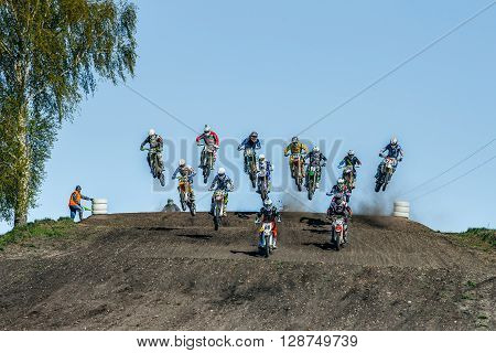Miasskoe Russia - May 02 2016: large group of riders on motorcycles jumping over a mountain during Cup of Urals motocross