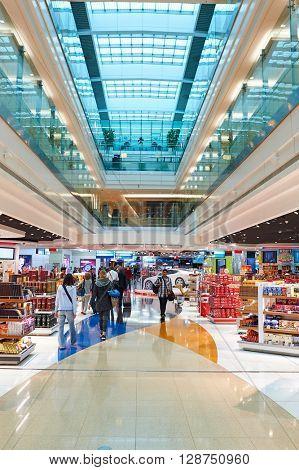 DUBAI, UAE - CIRCA JUNE, 2015: inside of Dubai International Airport. Dubai International Airport is the primary airport serving Dubai, United Arab Emirates