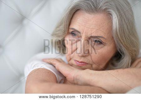 Portrait of a melancholy senior woman close up