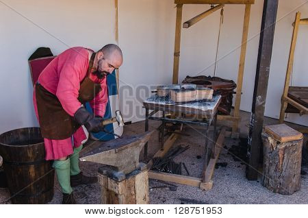 Smith Working In A Medieval Forge
