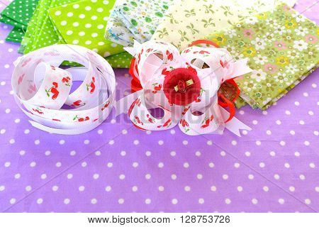 Beautiful bright bow of ribbon, children hair accessory, fabric set