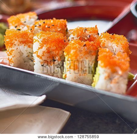 Sushi roll with red caviar traditional Asian Japanese food  - food decoration closeup