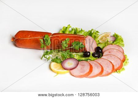 Still Life with sausages on a wooden table isolated on white background