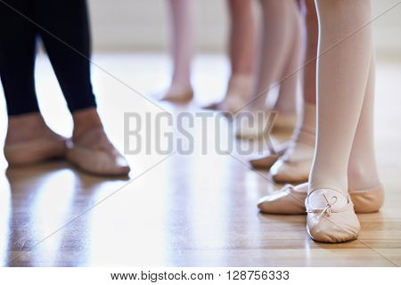 Close Up Of Teacher And Children's Feet In Ballet Dancing Class