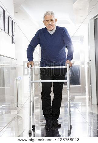 Senior Man Using Walker At Rehab Center