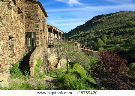 Stone house just across the road in the village of Patones above. Madrid. Spain